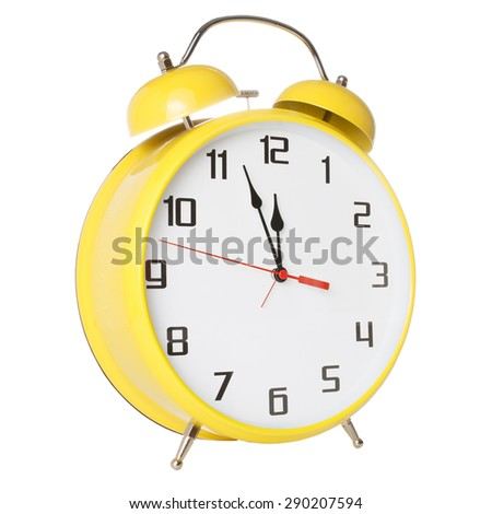 Yellow old style alarm clock isolated on white background - stock photo