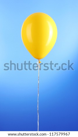 Yellow one balloon on blue background