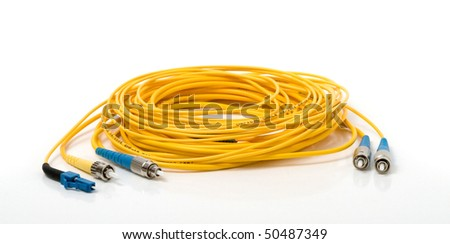 Yellow optic cable with connectors. Fiber optic connectors on the white background. - stock photo