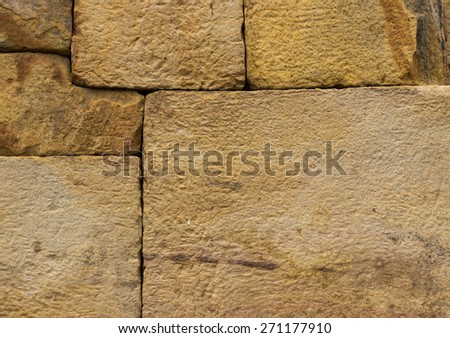 Yellow-orange stone wall - stock photo
