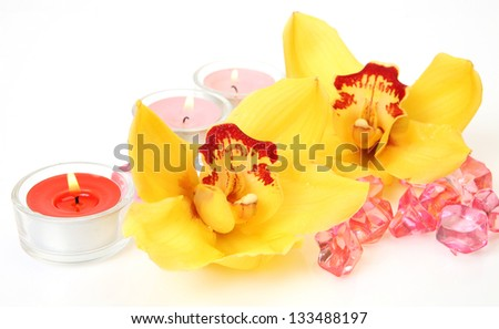 Yellow orchids and candles