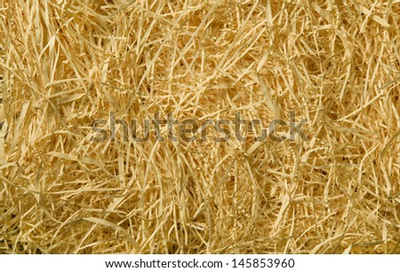 Yellow packing straw material background texture - stock photo