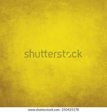 Yellow painted grunge canvas texture. - stock photo