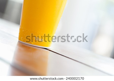 yellow paper cup 12oz. with water drop - stock photo