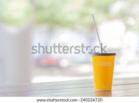 yellow paper cup 12oz. with wording cool in front - stock photo