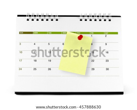 yellow paper note with red thumbtack on the calendar page isolated on white background - stock photo