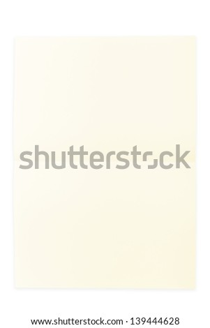 Yellow paper sheet folded in half isolated over a white background - stock photo