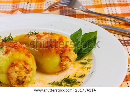 yellow paprika staffed with meat and rise filling - stock photo