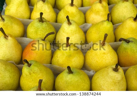 Yellow pears at a farmers market in France - stock photo