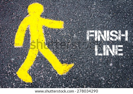 Yellow pedestrian figure on the road walking towards FINISH LINE. Conceptual image with Text message over asphalt background. - stock photo