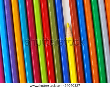yellow pencil among colorful ones set