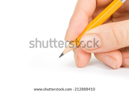 yellow pencil in hand isolated on white - stock photo