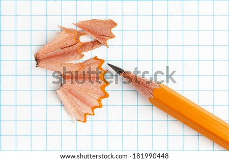 Yellow pencil on a paper sheet - stock photo