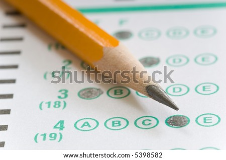 Yellow pencil on multiple choice test computerized answer sheet - focus is on the letter D in answer number 4 - stock photo