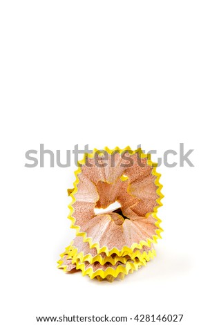 Yellow pencil shavings isolated on white. Vertical image.