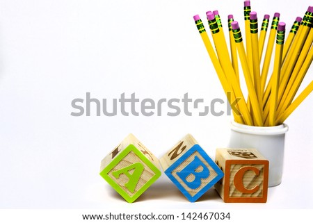 Yellow pencils and abc blocks for back to school - stock photo