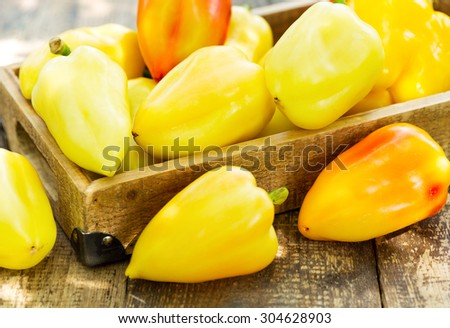 yellow peppers in the wooden box