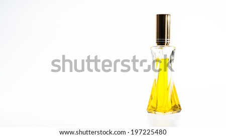 Yellow perfume Bottle in isolate - stock photo