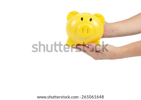Yellow piggy bank on man hand isolated on white background, clipping path included. - stock photo