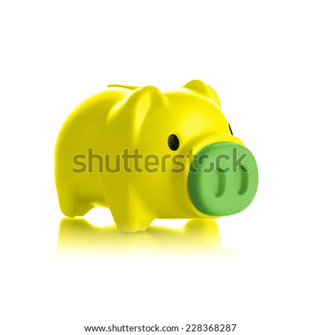 Yellow piggy bank on white background