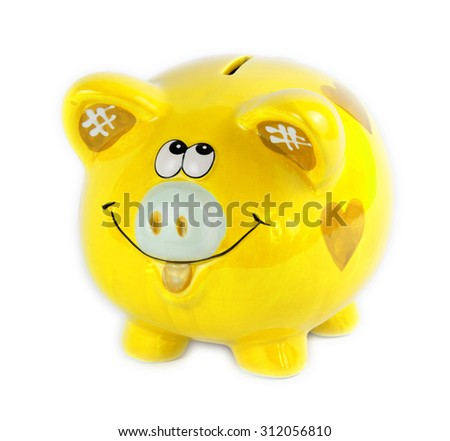 Yellow piggy bank style money box isolated on a white - stock photo