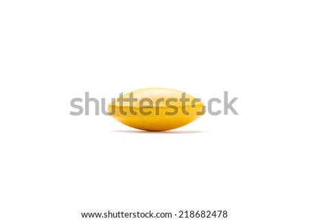 yellow pill, isolated on white background. Healthcare concept. - stock photo