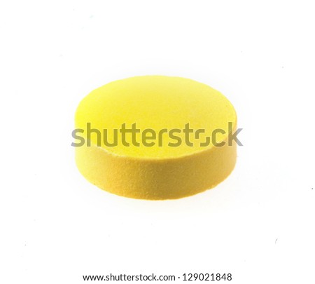 Yellow pill macro isolated on white background