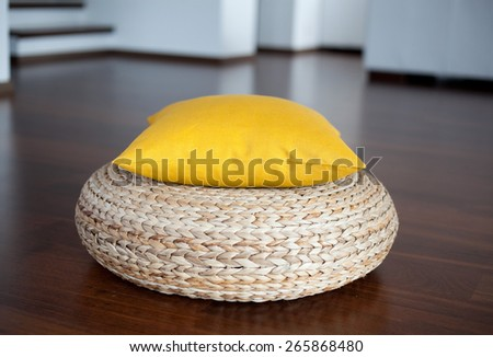 Yellow  pillow in white interior - stock photo