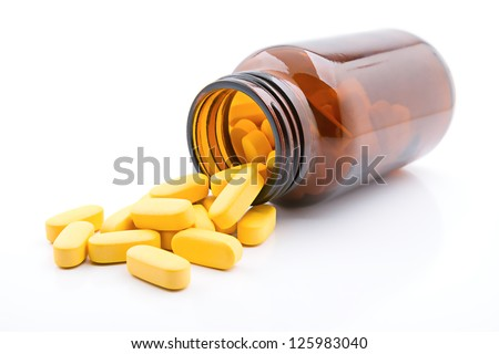 Yellow pills - stock photo