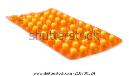 Yellow pills in a blister pack isolated on white background - stock photo