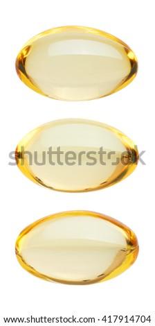 Yellow pills isolated on white background - stock photo