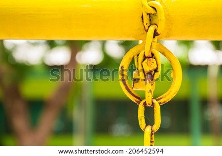 Yellow pipe bar and iron ring in park  - stock photo