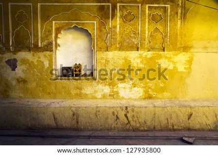 Yellow plaster and offering shrine, India, Jaipur