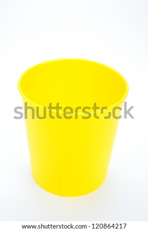 yellow plastic basket isolated over white background