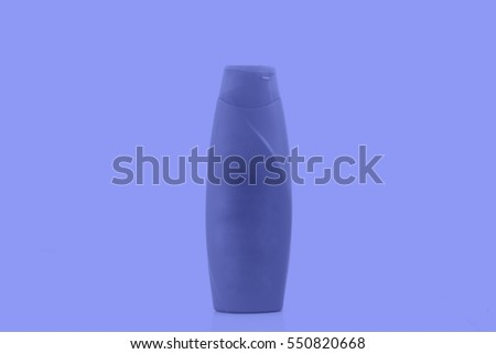 yellow plastic bottles in white background, closeup of photo