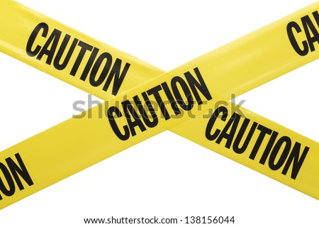 Yellow Plastic Caution Tape Crossed Isolated on White Background. - stock photo