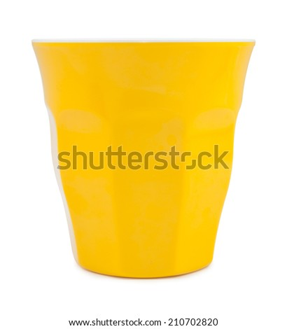 Yellow plastic glass on a white background,  file includes a excellent clipping path - stock photo
