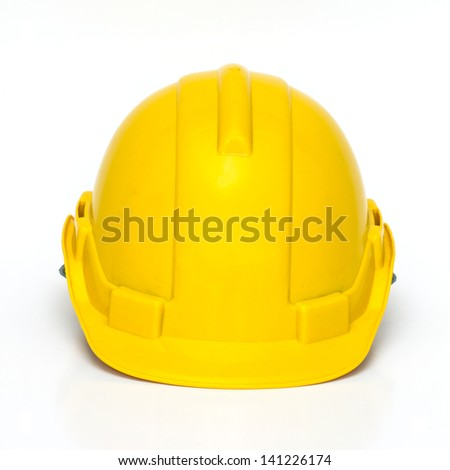Yellow plastic helmet or hard hat - stock photo