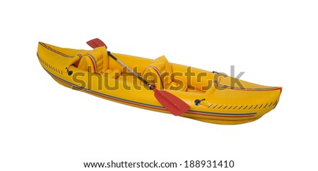 Yellow plastic kayak with paddle isolated on white. - stock photo