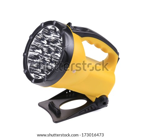 Yellow plastic pocket handle flashlight. Isolated on a white background.