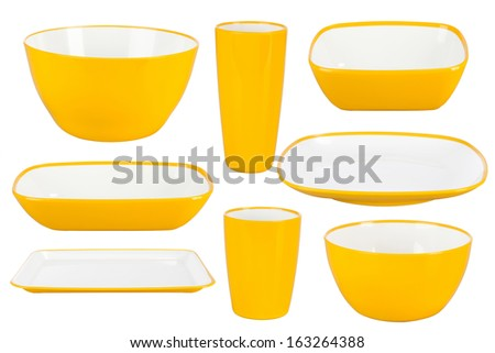 Yellow plastic tableware isolated on white background - stock photo