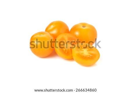 yellow plum tomato on white background - stock photo