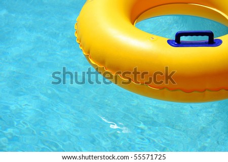 Yellow pool float/ring in pretty blue swimming pool