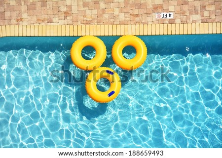 Yellow pool rings floating in a swimming pool