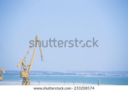 Yellow port crane - stock photo