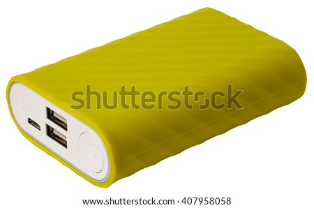 Yellow portable power bank for charging mobile devices isolated - stock photo
