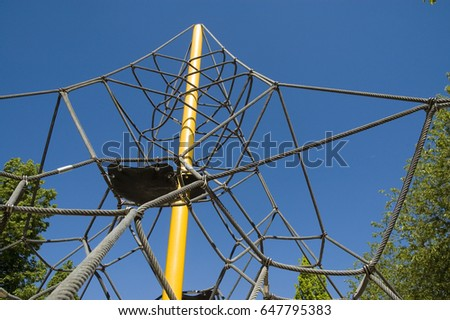 yellow post and thick ropes of a jungle gym/post, ropes and platforms/playground installation
