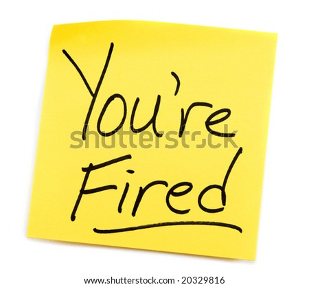 Yellow Post-it note with You're Fired message. - stock photo