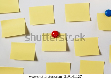 Yellow post its on whiteboard