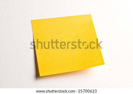Yellow postit note paper against white background - stock photo